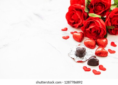 Valentines day romantic background -  chocolate candy and roses on a marble  background
