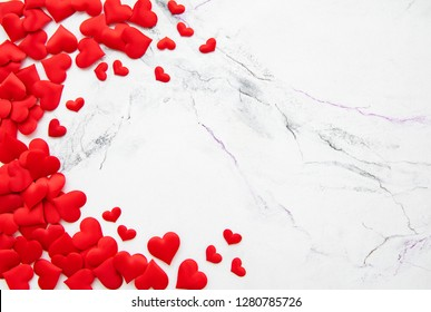 Valentines day romantic background - decorative hearts  on a marble background