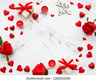 Valentines day romantic background - decorative hearts and roses on a marble background