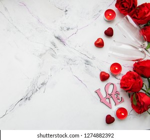 Valentines day romantic background - red roses, glasses, candle and hearts