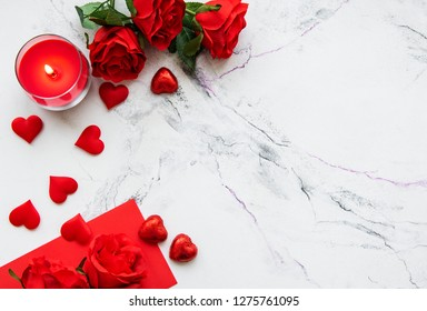 Valentines day romantic background - red roses, candle and hearts