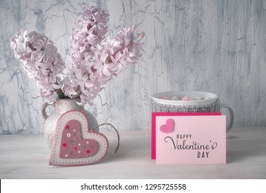 Valentines day still life blank paper cards with copy-cpace, wooden heart, cup of hot chocolate and pink hyacinth flowers on rustic background