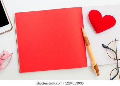 Valentines day and Sweetest day, love and red concept. Copy space for text with notebook and mobile phone