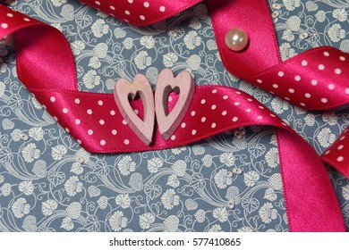 Valentine's day symbol hearts on a pink ribbon.
