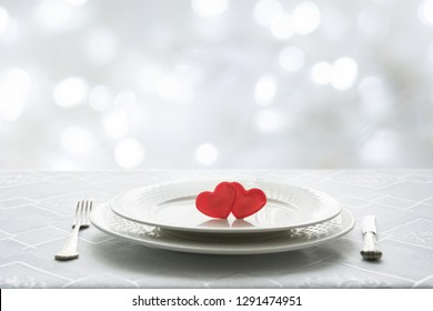Valentines day table place setting with two hearts in cafe. Space for text. Invitation for a date.