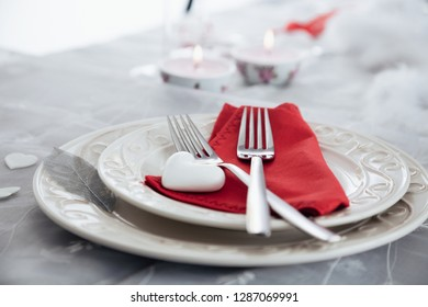 Valentines day table. Plate with two forks and hearts. Valentine's day dinner.St. Valentine table setting