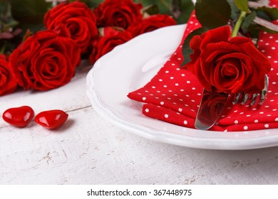Valentines day table setting with plate knife fork napkin and red roses. & Romantic Table Setting Valentines Day Stock Photo (Edit Now ...