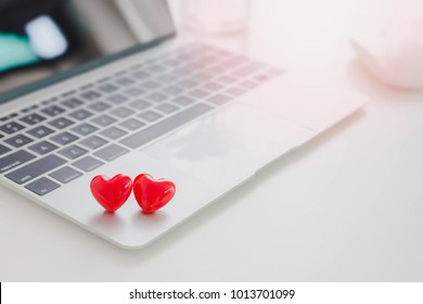 Valentines Day theme,Couple red hearts on laptop on white table in office.Concept of Online dating.