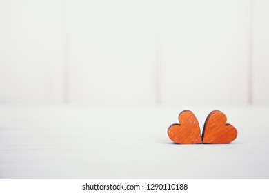 Valentines day two red hearts on white wooden background. Holidays card with copy space.