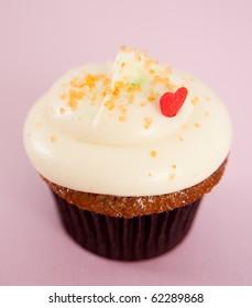Valentine's Day Vanilla Cupcake on Colorful Background