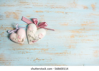 valentines day or wedding background with shabby chic heart on old, painted wood and copy space. love concept