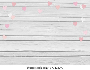 Valentines day or wedding mock up scene with paper hearts confetti and old white wooden background, empty space for your text, top view