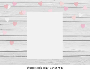 Valentines day or wedding mockup scene with blank card, paper hearts confetti and wooden background, empty space for your text, top view