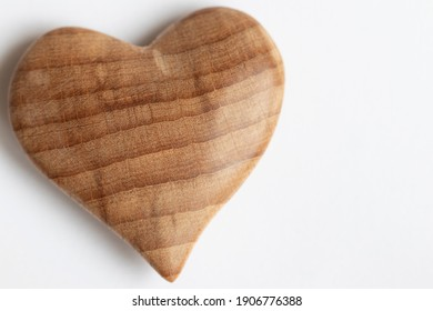Valentine's day, wooden heart on a light background.