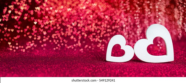 Valentines Day - Wooden Hearts On Red Shiny Background