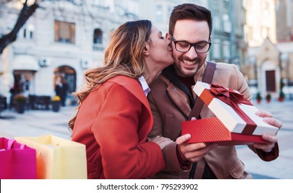Valentine's day. Young man surprised his girlfriend with a present. Relationships, love, dating