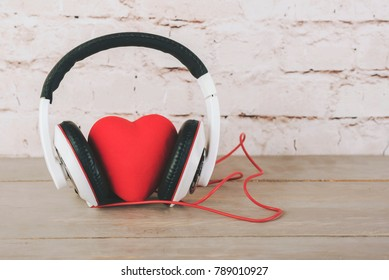Valentine's Day,heart with headphones on a wooden table
