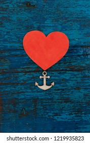 valentine's day,wedding,anniversary card/red heart and anchor on blue rusty wooden background/eternal love concept