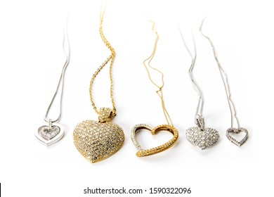 valentines heart gold and diamond jewellery and necklaces isolated on white