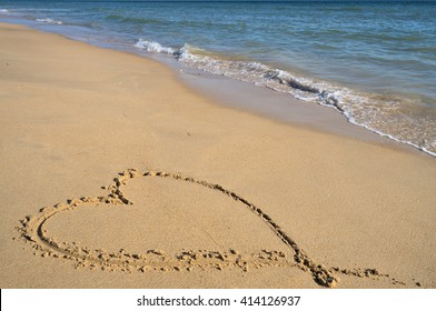 Valentine's love heart on the beach sand. Honeymoon vacations and Valentine's Day theme
