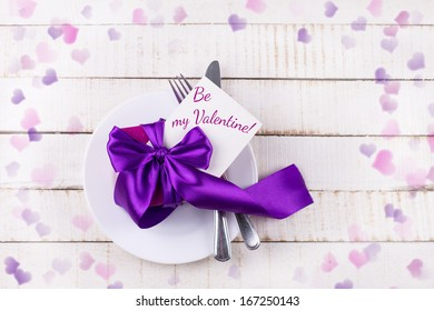 Valentines  table setting on white wooden background. Place for your text.  Selective focus.