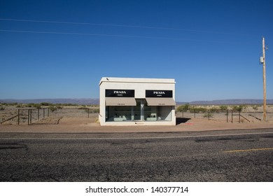 VALENTINE,TX,USA-MAY 30: A Prada storefront sits along deserted highway 90 on May 30, 2013. This sculpture was intended never to be repaired and to slowly degrade into the natural landscape.