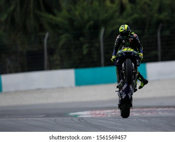 Valentino Rossi of Italy and Yamaha Factory Racing lifts the front wheel during the MotoGP of Malaysia - Qualifying at Sepang Circuit on November 02, 2019 in Kuala Lumpur, Malaysia.