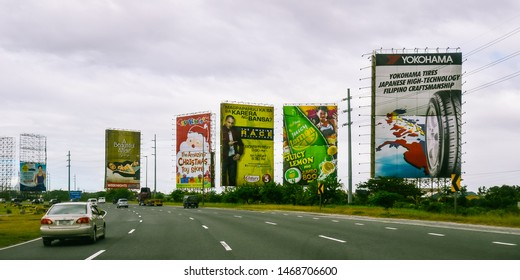 Valenzuela, Bulacan/PH - Dec. 29, 2012: Giant billboards greet travelers on Northern Luzon Expressway, Valenzuela, Bulacan, Philippines.