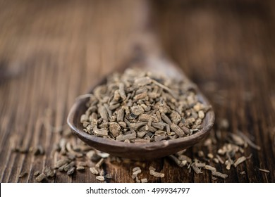 Valerian roots (dried; detailed close-up shot) on wooden background