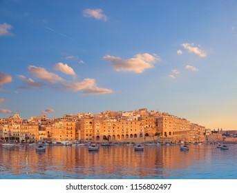 Valetta Grand harbor in the morning, Senglea peninsula across the bay from Vittoriosa, toned panoramic image