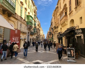 Valetta, Malta - February 23, 2019: Central street of the city in a winter sunny day