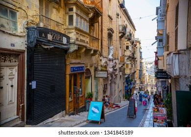 Valetta, Malta - September 2018: Traditional Maltese architecture. Old historical houses with colorful wooden balconies in La Valetta, Malta