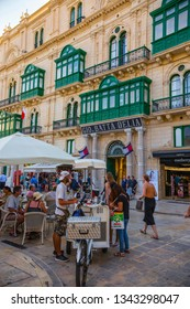 Valetta, Malta - September 2018: Traditional Maltese architecture. Old historical part of La Valetta with people outside and narrow streets, Malta