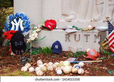 Valhalla, NY, USA February 27, 2012 Baseballs and other offerings are left at the grave Yankee slugger Babe Ruth in Valhalla, New York