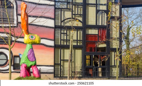 VALKENBURG, NETHERLANDS - NOVEMBER 22, 2014: Sculpture in front of the main building of the Hundertwasser house in Valkenburg Netherlands.