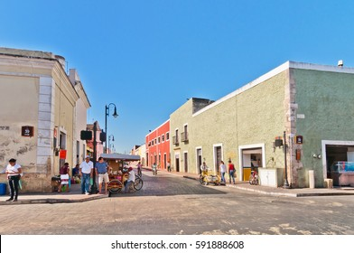 Valladolid, Mexico - April 21, 2014: locals and tourists in downtown street with typical colonial buildings in Valladolid, Yucatan, Mexico. The city was established in 1543.