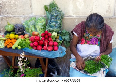 VALLADOLID, MEXICO - FEBRUARY 11: Women with fruits and vegetables for sale in Valladolid, Mexico on February 11, 2017