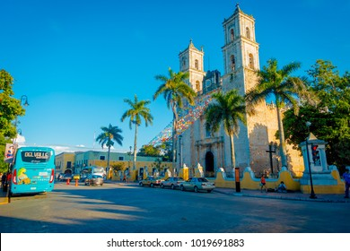 VALLADOLID, MEXICO - NOVEMBER 12, 2017: Unidentified people walking at outdoors of Church of San Servacio Saint Servatius in Valladolid, Yucatan, Mexico