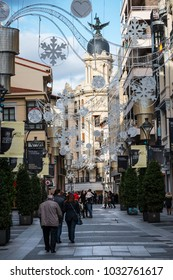 VALLADOLID, SPAIN - DECEMBER 30, 2017: Crowded Calle de Santiago in Valladolid city center decorated with the Christmas lights, on December 30, 2017.