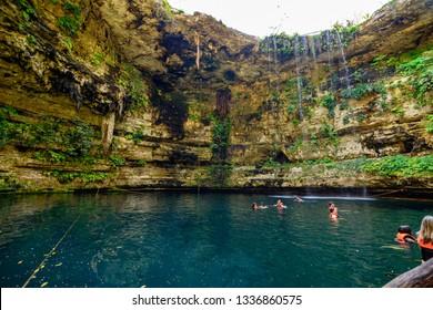 Valladolid, Yucatan/Mexico - 02 21 2019: Tourists swimming in a cenote