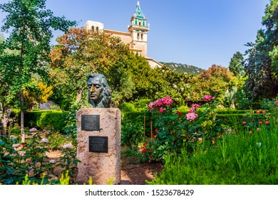 Valldemossa Mallorca Spain July 2015 Statue of Frederic Chopin Polish composer and virtuoso pianist of Romantic era garden and mansion in background