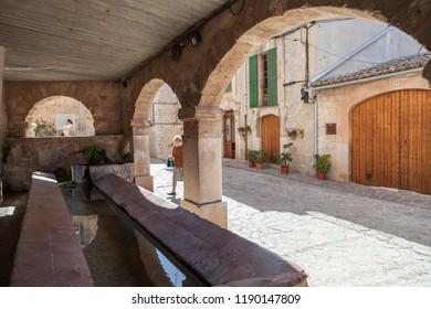 VALLDEMOSSA,SPAIN-APRIL 15,2013:Old town street and public laundry of Valldemossa,Mallorca,Spain.