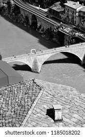 Valle d'Aosta, Italy, August 2018, medieval bridge on the Dora Baltea river that connects Bard with Hone