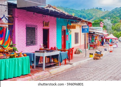 Valle de Angeles, Honduras - November 26, 2016: Vendors on the street in touristic town Valle de Angels in Honduras. It used to be old Spanish mining town.