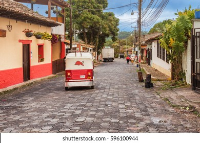 Valle de Angeles, Honduras - November 26, 2016: Tuc Tuc motor taxi running on streets in touristic town Valle de Angels in Honduras. It used to be old Spanish mining town.