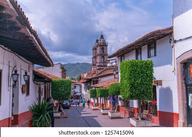 Valle de Bravo, Mexico - July 19, 2018: beautiful panoramic view of a traditional street in the center of Valle de Bravo with people admiring the architectural beauty