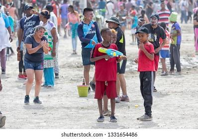 Valle de Chota, Ecuador- March 4, 2019: young boys at the 'Olas del Rio' carnival