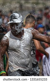 Valle de Chota, Ecuador- March 4, 2019: man drenched in foam during the 'Olas del Rio' carnival
