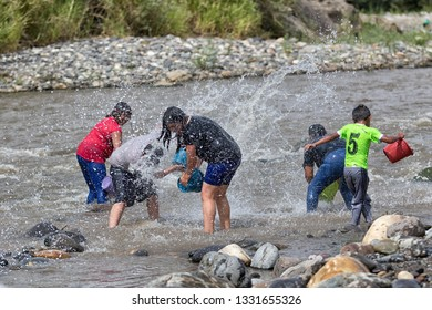 Valle de Chota, Ecuador- March 4, 2019: people throwing river water at each other during the 'Olas del Rio' carnival