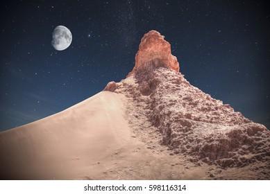 Valle de la Luna (Moon Valley) close to San Pedro de Atacama, Chile. night shining stars.